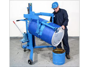 A person operating a large blue drum palletizer pourer, dumping a substance into a smaller bucket