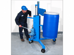 Man operating a drum transporter to raise an upright blue drum with a white lid.