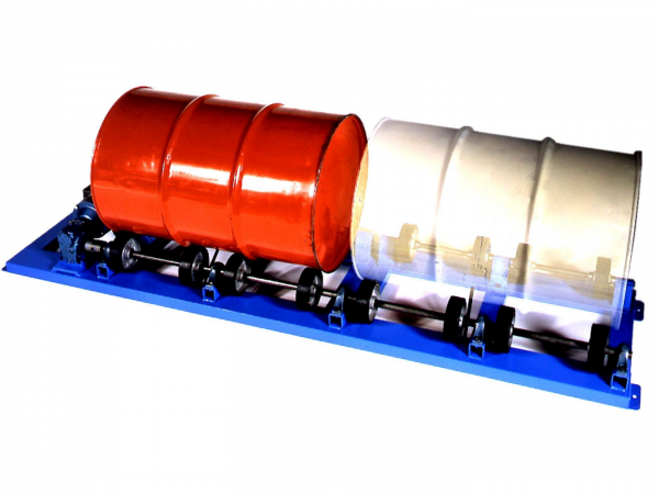 Red and white drums side-by-side on drums rollers for drum handling and transportation, available from Stewart Handling